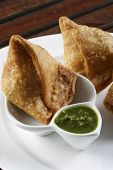 stock photo of samosa  - Samosa  is an Indain fried or baked pastry with a savory filling - JPG