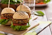 stock photo of veggie burger  - Vegan burgers with  beans and vegetables on a cutting board - JPG