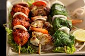 picture of kababs  - Kebab (or originally kabab is a wide variety of skewered meals originating in the Middle East and later on adopted in Turkey, Azerbaijan, Balkans, Spain