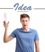 Young man with lamp energy saving, isolated on white