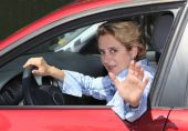 image of say goodbye  - Female driver saying  - JPG