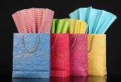Colorful shopping bags, isolated on black