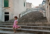 Girl On A Baroque Staircase