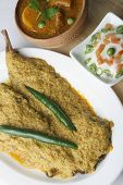 stock photo of bengali  - Top view of Hilsa fish curry - JPG