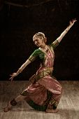 Vintage retro style image of young beautiful woman dancer exponent of Indian classical dance Bharata