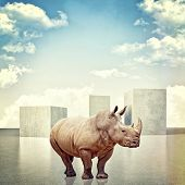 stock photo of rhino  - 3d image of huge concrete block and rhino - JPG