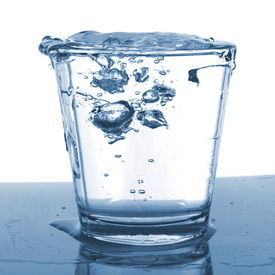 pic of drinking water  - splashing water pouring in a glass with bubbles - JPG