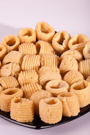 stock photo of urad  - Seepu Seedai is a traditional snack from South India which is made with rice flour - JPG