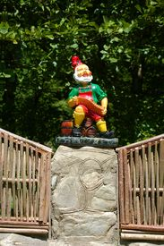 foto of  midget elves  - statuette of the small gnome playing on harmonica - JPG
