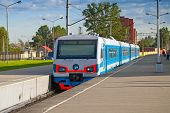 image of railcar  - Modern suburban electric train standing at the station - JPG