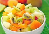 image of fruit bowl  - Bowl with fruit salad on green table - JPG