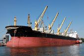 Big Industrial Cargo Ship Loading In Port