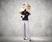 Confident businesswoman wearing carton box on head