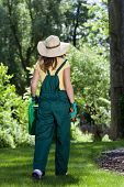 Gardener Woman Walking In Garden