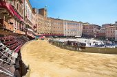 Piazza del Campo in the preparation of the sandy substrate for the place of the Palio horse race, wi