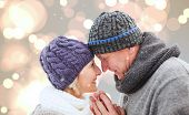 Mature winter couple against white glowing dots on grey