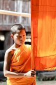 An Unidentified  Young Novice Monk 12 Years Old Poses For A Photo