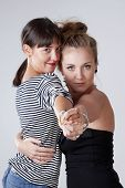 Two Young Female Friends Dancing Tango