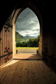 Through the arched doorway