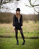 Beautiful Young Woman Dressed In Black Wearing Bowler Hat