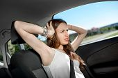 Young Sad Woman Shouts Holding His Head Standing In The Car In The Traffic