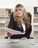 Beautiful Businesswoman Handing Over Paperwork