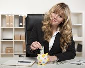 Happy Businesswoman Saving For Retirement