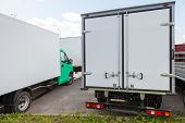 Rear View Of New Standing White Cargo Trucks