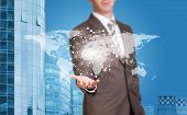 Business man hold world map and wire-frame sphere