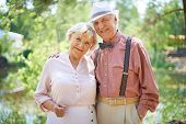image of sweethearts  - Happy seniors in smart casual enjoying summer rest - JPG