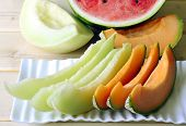 foto of cantaloupe  - Cantaloupe melon slices of fresh juicy yellow red green - JPG