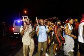 Men hefting Caribbean tamborines