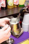 Woman preparing coffee, close up