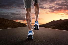 image of crossed legs  - Close up of athlete - JPG