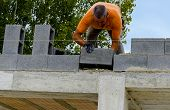 foto of mason  - Mason performs an external masonry blocks concrete - JPG