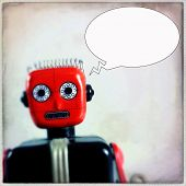 Instagram filtered image of a vintage toy robot with a thought bubble
