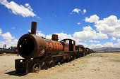foto of railroad car  - Old rusty railroad cars abandoned in the desert - JPG