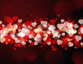 Valentine's Day background with red and gold bokeh lights and hearts