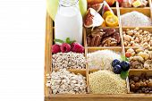 Breakfast items in wooden box isolated