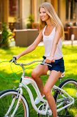 Relaxing With Her Bicycle.