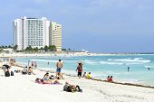 CANCUN - JANUARY 23: Tourists enjoy the sunny weather and relaxing on the beautiful beach on 23 January 2015 in Cancun, Mexico. This is one of the best beaches in the Mexico.
