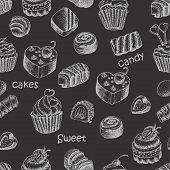 Seamless pattern with sweet cakes and candy on a black background
