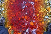 foto of water pollution  - Red polluted water stream in Geamana Romania - JPG