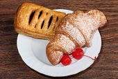 Croissant And Pie From Flaky Pastry