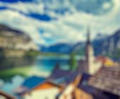 Vintage retro effect filtered hipster style Austria blurred background of  Austrian tourist destination Hallstatt village on  Hallst�?�?�?�¤tter See in Austrian alps. Salzkammergut region, Austria