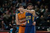 VALENCIA, SPAIN - JANUARY 24: Neto 8 and Vives during Spanish League match between Valencia Basket Club and UCAM Murcia at Fonteta Stadium on January 24, 2015 in Valencia, Spain