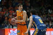 VALENCIA, SPAIN - JANUARY 24: Vives (L) and Neto during Spanish League match between Valencia Basket Club and UCAM Murcia at Fonteta Stadium on January 24, 2015 in Valencia, Spain
