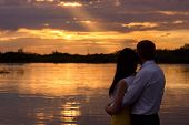 couple near the water at sunset