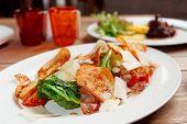 Creative caesar salad on restaurant table