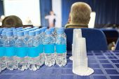 bottles of water and glasses in the conference hall